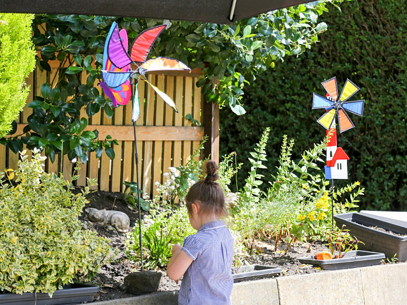 Coteswood House Pre-school and Day Nursery, child in garden